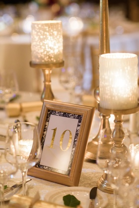 Gold candle holder gold frame gold foil table number with floral print border navy blue