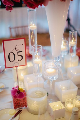 Printed table number with fuchsia border in rock vase