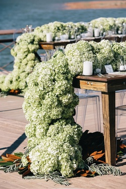 Rustic wood tables topped with green hydrangeas
