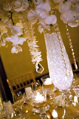 Garlands of orchids and crystals hanging from flowers