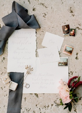 Wedding ring in velvet box with flowers postage stamps ripped paper raw edge invitation calligraphy