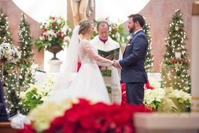 wintry ceremony christmas details bride groom north carolina wedding trees catholic church pews