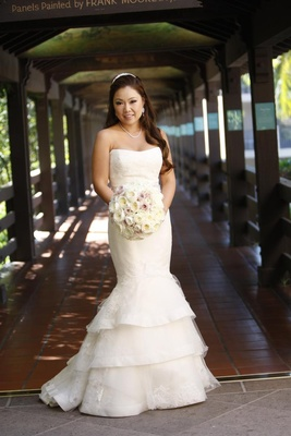 Asisan bride in strapless dress holding neutral bouquet