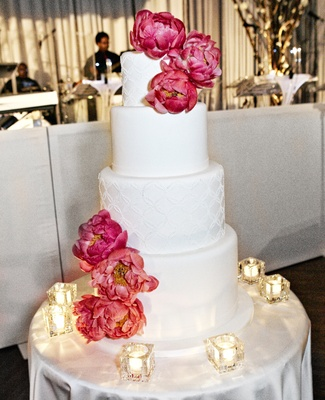 White Wedding Cake With Fresh Pink Peony Flowers