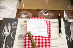 Chalkboard placemat with gingham napkin, rosemary sprig, and wine menu