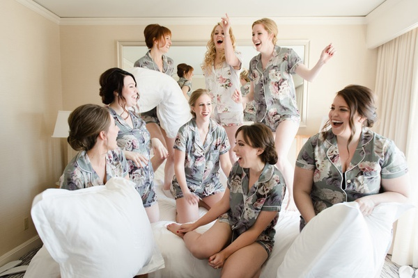 bride and bridesmaids in matching pajamas, bridesmaid pillow fight during getting ready