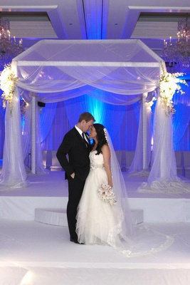 Bride and groom in front of chuppah at Chicago wedding