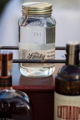 Mason jars on bar cart at reception