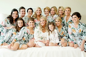 bridesmaids and flower girl with bride on wedding day getting ready morning flower print robes