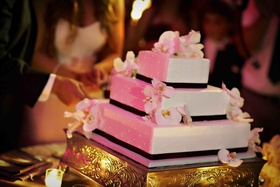 Black and white pearl dot wedding cake with orchids
