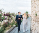 bride in galia lahav wedding dress with plunging neckline, groom in navy tuxedo, capri wedding