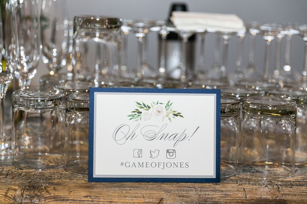 wedding hashtag sign #GameofJones oh snap with facebook twitter and instagram symbol logos flowers