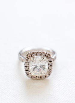 Cushion-cut diamond engagement ring with halo setting