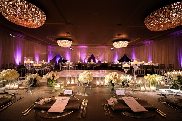 Wedding reception Fairmont Miramar Hotel & Bungalows ballroom purple lighting and white flowers grey