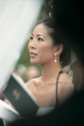 Bride wearing diamond and pearl drop earrings