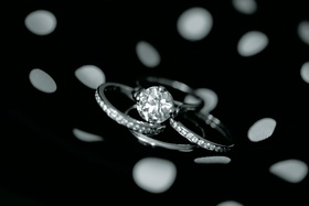 black and white engagement ring and three wedding bands