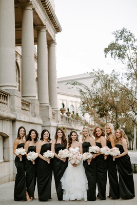 bride with bridesmaids in strapless bridesmaid dresses hair down loose curls white pink bouquets