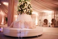 Monogrammed pink pillows and tufted furniture