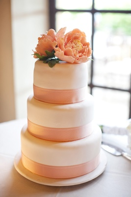 White Fondant Wedding Cake With Pink Ribbon And Pink Peony
