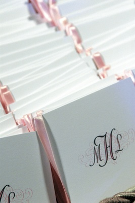 pink and white programs with monogram