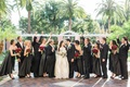wedding party cheers bride groom black dresses suits red bouquets ivory wedding dress florida
