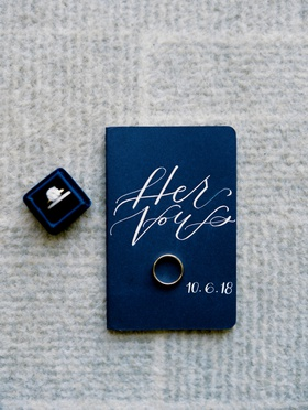 navy vow book and navy mrs. box, engagement ring