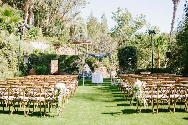 wedding ceremony wood vineyard chairs grass lawn houdini estate chuppah pampas grass palm trees