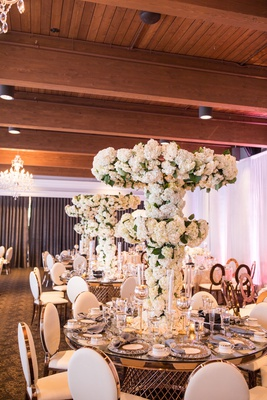 wedding reception gold table tall centerpiece tree white flowers hydrangea rose orchid flowers