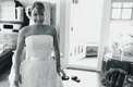 Black and white image of bride getting ready in boudoir