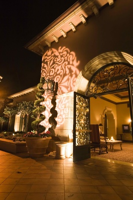 Illuminated wall and topiary at Grand Del Mar