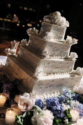 Square cake decorated with blue and white flowers