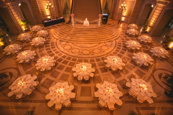 Wedding reception in the rotunda of San Francisco City Hall with pink marble floor