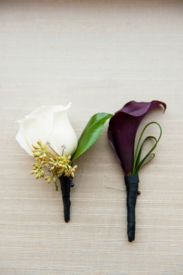 White rose and purple calla lily wrapped in ribbon