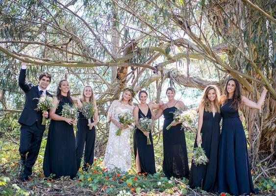 bride bridesmaids bridesman male bridesmaid navy blue dresses tuxedo wildflower bouquets