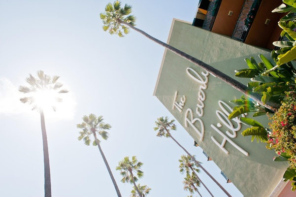 LA wedding venue sign and palm trees