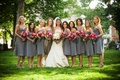 Bride in a Monique Lhuillier gown and bridesmaids in slate grey tea-length dresses