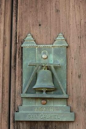 Metal knocker on wooden church door