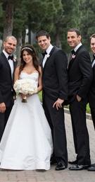 Bride in oscar de la renta wedding dress groom in tuxedo with groomsmen six boutonnieres