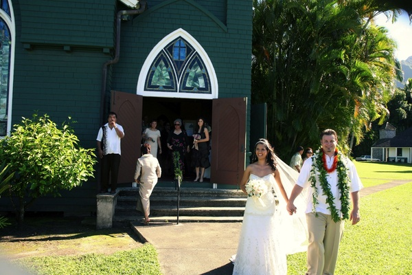 bride and groom leave church after ceremony in hawaii