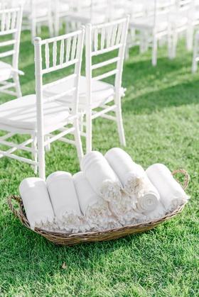 wedding ceremony green grass lawn white chairs blankets fleece in basket wedding ideas