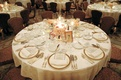 Large vase with candles, gold plates and flatware