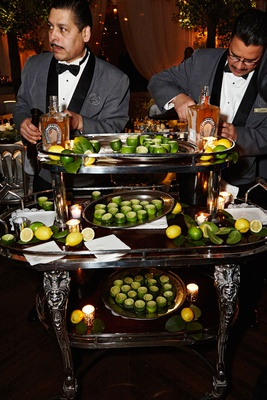 large bar cart with hollowed out limes for shot glasses tequila Tequila Herradura and limes servers