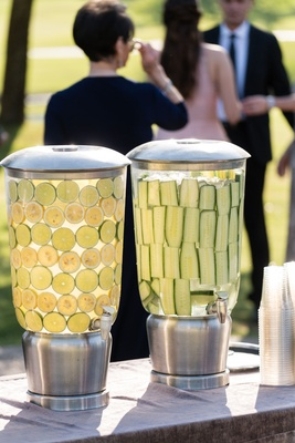 Outdoor ceremony with water drink dispensers lemon lime flavor and cucumber