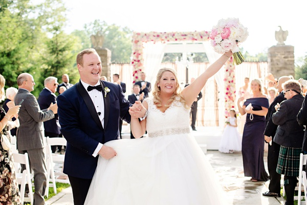 wedding ceremony outdoor spring summer pink flowers bride and groom recessional guests celebrating