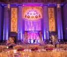 Mellon Auditorium wedding reception with purple lighting
