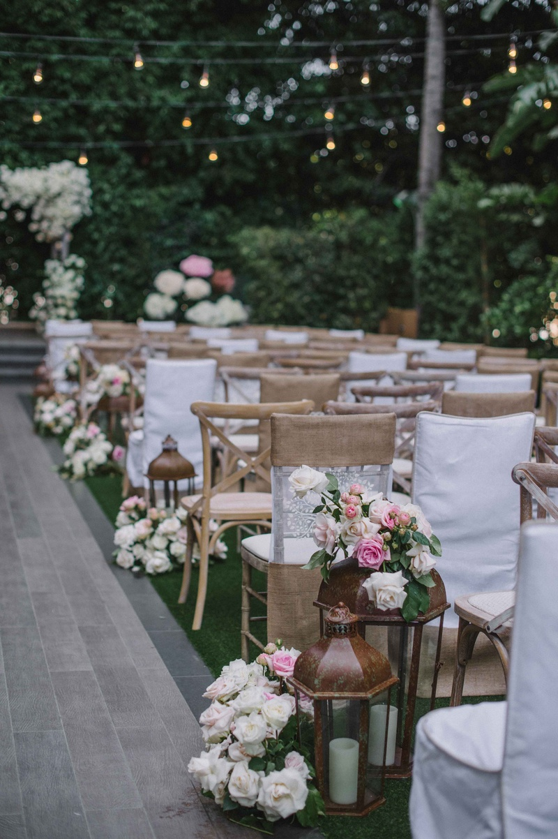 Beverly Hills Four Seasons Wedding Ceremony Outdoor Rustic Chairs Lanterns  White Pink Roses