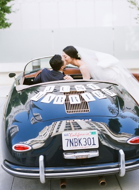 bride kissing groom in just married car porsche 356 speedster california license place