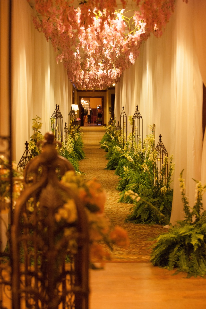 Wedding reception hallway entrance with pink flowers from ceiling