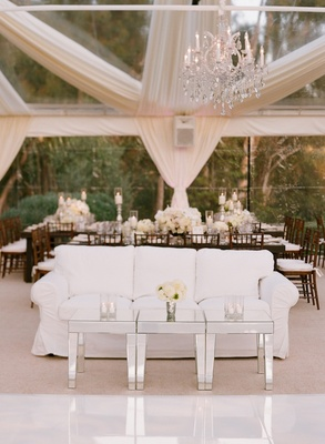 White slipcover couch next to dance floor at reception