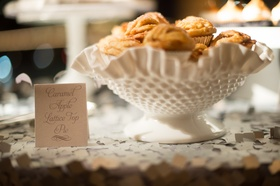 White scalloped bowl with mini pies that look like cupcakes